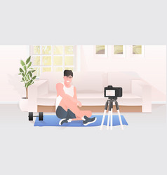 Male fitness trainer recording video blog using vector