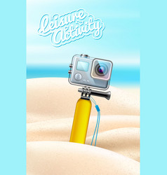 Realistic action camera on beach sand background vector