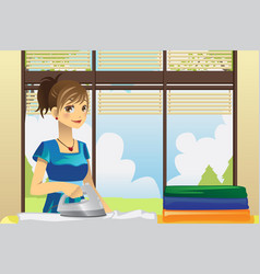 Housewife ironing clothes vector
