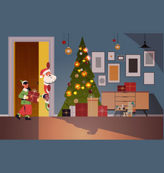santa claus with elves peeking out from behind vector image