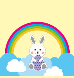 Cute rabbit sitting in clouds decorative egg and vector