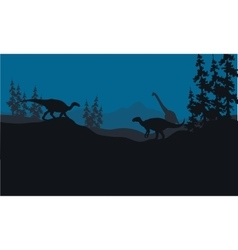 Silhouette of brachiosaurus and iguanodon in hills vector