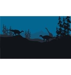 Silhouette of Brachiosaurus and Iguanodon in hills vector