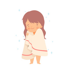 Little girl covered with towel for drying after vector
