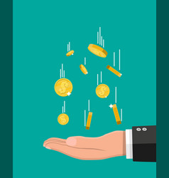 falling gold coins and hand money rain vector image