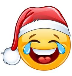 tears of joy emoticon with santa hat vector image