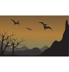 Pterodactyl silhouette in mountain vector
