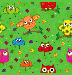 Seamless pattern with ornamental owls over green vector