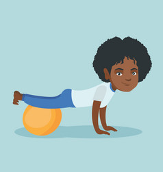 Young african woman exercising with fitball vector