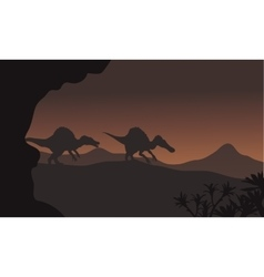 Silhouette of two spinosaurus walking in hills vector image