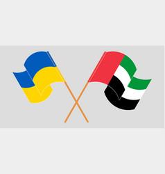 Crossed and waving flags ukraine vector