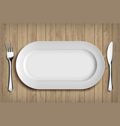 White ceramic plate fork and knife on table vector