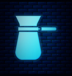 Glowing neon coffee turk icon isolated on brick vector