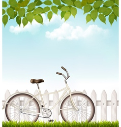 Bicycle in front of a white fence with green vector image vector image