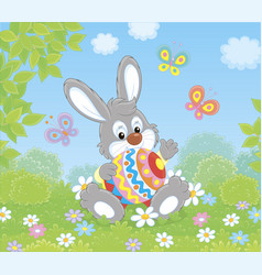 little bunny with a decorated easter egg vector image