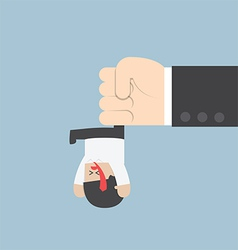 Businessman hanging from upside down by a big hand vector image