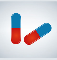 blue and red pills isolated on white background vector image