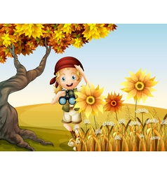 A girl holding a telescope near the sunflowers vector image vector image