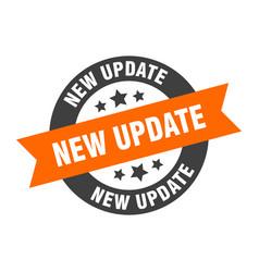 New update sign new update orange-black round vector