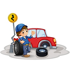 a boy fixing a red car vector image