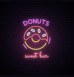 Neon sign of sweet donuts neon cafe emblem vector