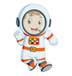 Cartoon boy wearing astronaut costume vector