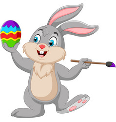 cartoon rabbit painting an easter egg vector image