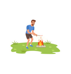 Smiling bearded man roasting sausage over campfire vector