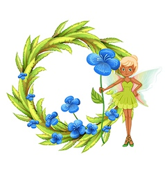 A round leafy border with a fairy holding a blue vector image