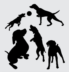Dog playing silhouette vector