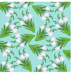 Pattern from snowdrops on a turquoise background vector