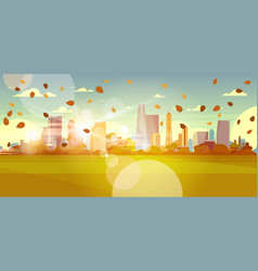 Autumn cityscape skyline with leaves flying in vector