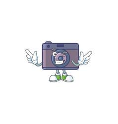 A comical face retro camera mascot design with vector