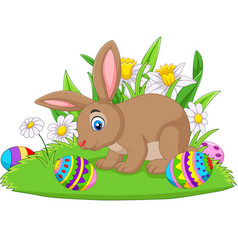 cartoon bunny with easter egg on the grass vector image