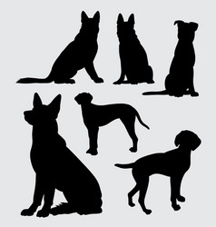 German shepherd and dalmatian dog silhouette vector