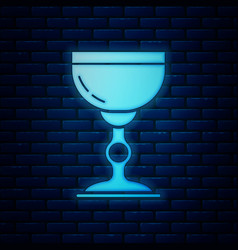 Glowing neon jewish goblet icon isolated on brick vector