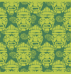 Tribal totem mask seamless green textured pattern vector