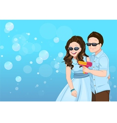 Playful couple cartoon with soap bubble guns vector image vector image