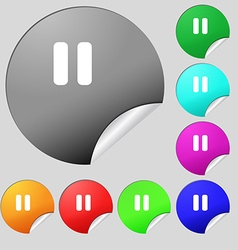 Pause icon sign Set of eight multi-colored round vector