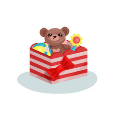 striped box with red bow full of children toys vector image