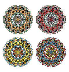 set of four flower mandalas in different colors vector image