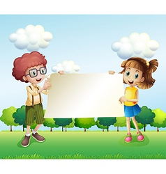 A boy and a girl holding an empty signage vector image