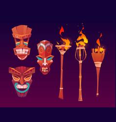 Tiki masks and burning torches tribal wood totems vector