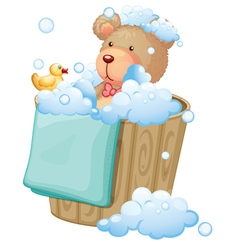 A bear inside the pail full of bubbles vector image vector image