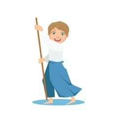 Boy with the stick in wide trousers on karate vector
