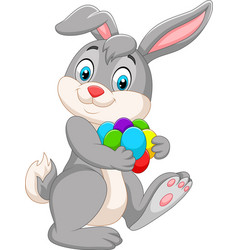 cartoon easter bunny carrying colorful eggs vector image