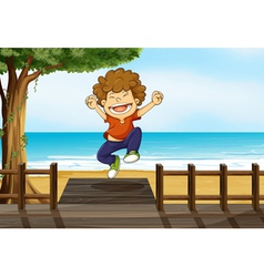 A boy jumping in the bridge vector image