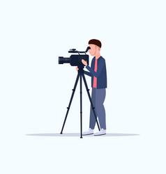 Operator using video camera on tripod cameraman vector