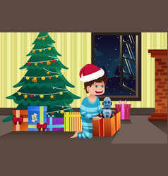 Boy opening a present under the christmas tree vector