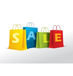 Colored paper bags on white vector image